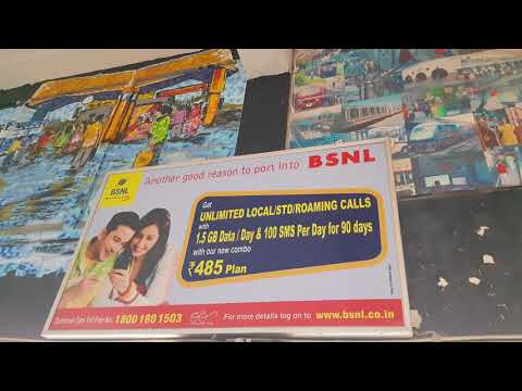 Commercial billboards covering beautiful wall paintings at New Delhi Railway Station
