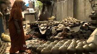 Potter making diyas (clay lamps) before Diwali festival