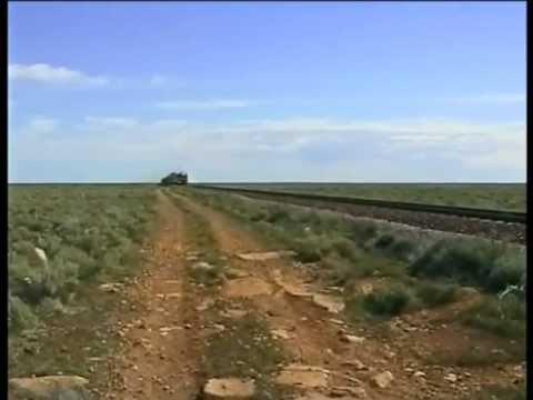 The 'singing rails' of a passing goods train, on the Nullarbor Plain.