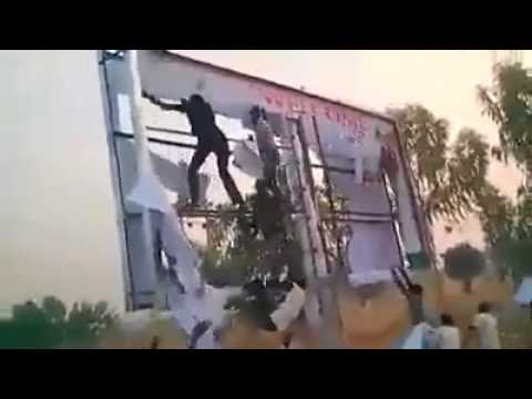 APC Supporters Destroying Jonathan's Campaign Billboard