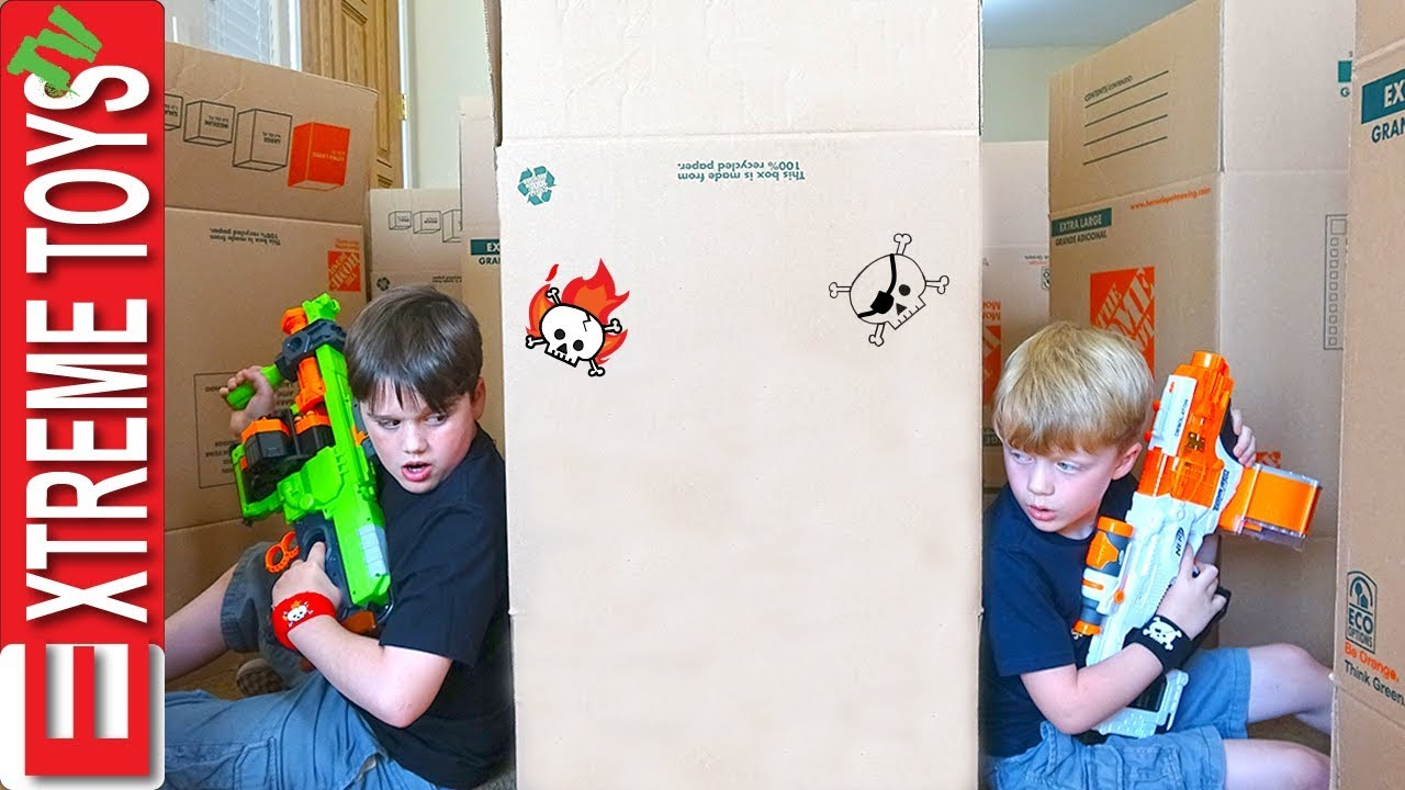 Ethan Vs. Cole Nerf Battle Royale in a Cardboard Box Maze Fort!