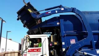 Suburban Carting front loading Mack garbage truck