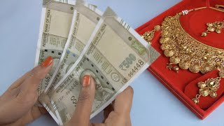 Young female counts a bundle of Indian currency notes - gold loan or gold mortgage