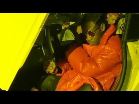 Offset Migos pulls up to the vfiles fashion show runway in a yellow lamborghini