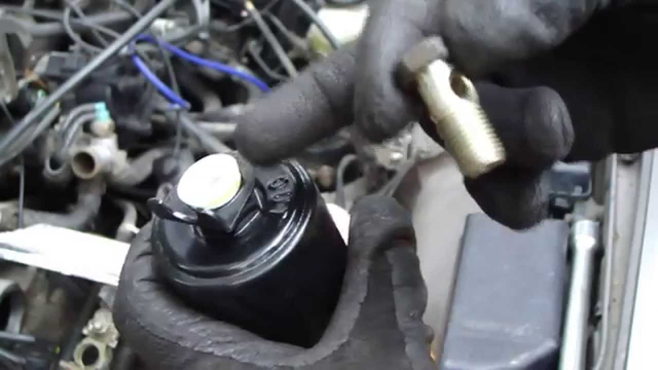 how to replace fuel filter toyota camry  2 2 liter engine  years 1991 to  2002  - youtube