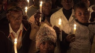 Two thousand people gathered in the cold night air as a candlelight vigil was held to pray for Lerato Moloi, and the many other young woman who have been murdered and abused in Soweto recently.  Various members of the local church community condemned those who commit murder, rape and crime - calling for them to repent and answer to the almighty at the prayer service.  Lerato Moloi's cousin believes the community can defeat the bad elements they face, as she spoke fondly about her cousin who she called her 'uncle'.