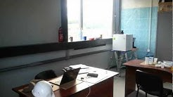 Laboratory which is used as temporary office and storage area.