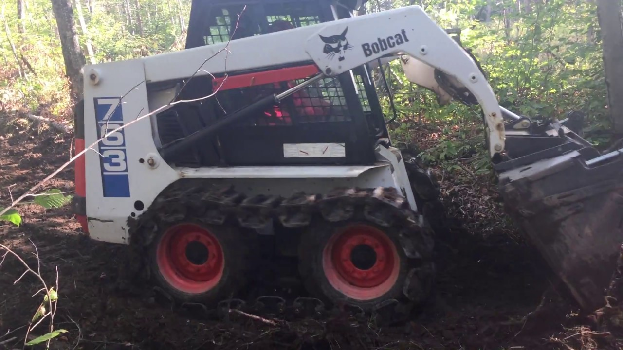 763 Bobcat With Grouser Tracks Grading Atv Trails Youtube