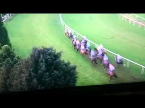 Davy Russell borrows a whip from Phillip Enright after dropping his early on