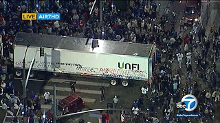 Crowd in DTLA loots semi-truck during World Series celebration | ABC7