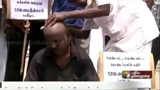 DMK Members Shave Heads to Protest Against T. P. M. Mohideen Khan