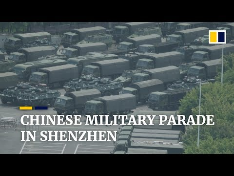 Chinese military personnel parade in Shenzhen