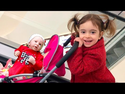 Little Girl Pushing Silicone Baby Stroller