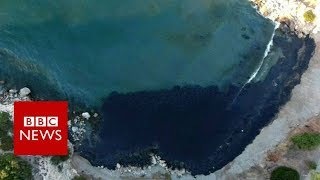 Oil spill turns Greek island bay black - BBC News