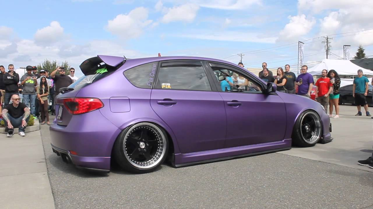 Matte Purple 08 WRX on air ride with custom straight pipe