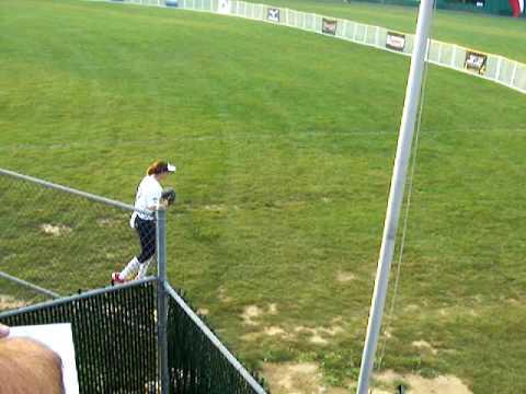Monica Abbott warms up pitching