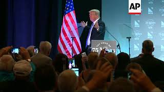 Trump Hugs Flag After Immigration Speech