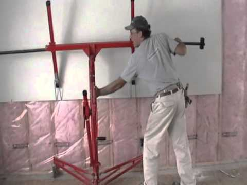 Installing Drywall On Upper Walls With Lift By Laurier Desormeaux