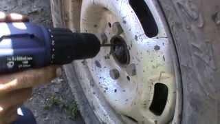 Откручивание гайки ступицы и снятие тормозного барабана
