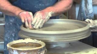 Jack making a large platter,  jackboylepottery@tampabay.rr.com