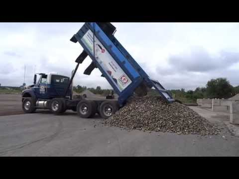 Greely Sand & Gravel unloading a full triaxle load of river rock
