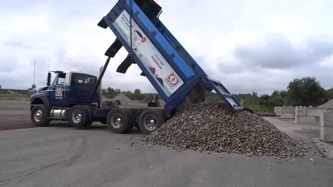 10 Ton River Rock : Greely sand gravel unloading a full triaxle load of