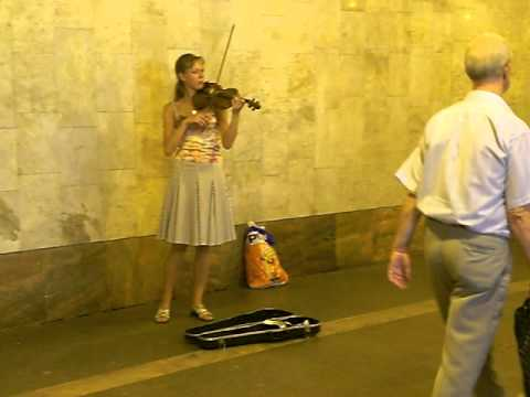 Moscow beauty girl playing a violin in the underground