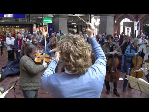 Flash mob at Copenhagen Central Station. Copenhagen Phil playing Ravel's Bolero.