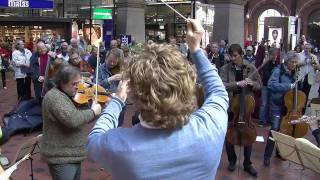 Flash mob at Copenhagen Central Station. Copenhagen Phil playing Ravel