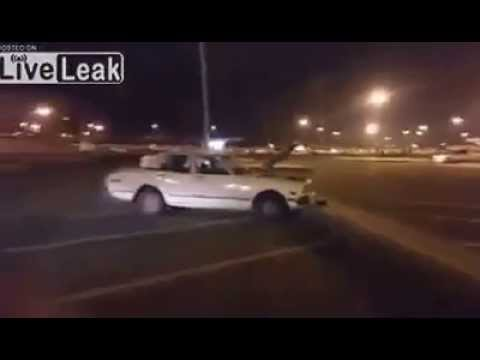LiveLeak.com - WTF : Saudi man decided to watch a football game in a parking lot