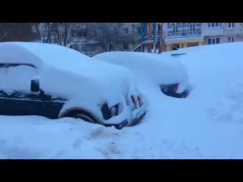 Машины полностю в снегу