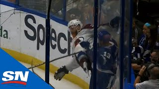 Cedric Paquette Rocks Ian Cole Against The Boards Knocking Him Down To The Ice