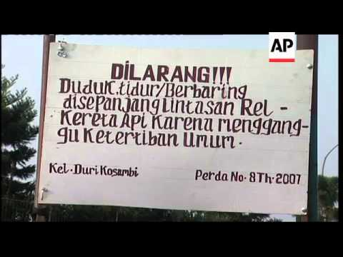 Desperate Indonesians turn to rail ''therapy''