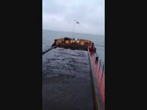 A Hopper Barge dropping its load