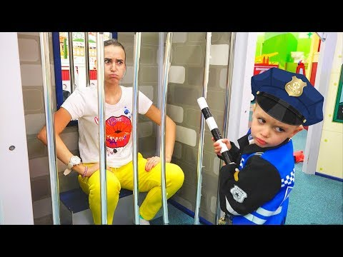 Vlad and mama play at the game center for children