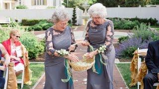 grandmothers wear matching dresses to walk down aisle as flower girls