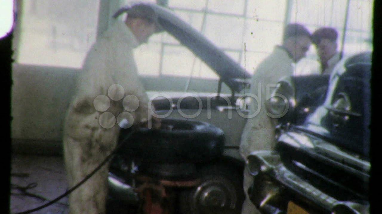 car auto repair garage mechanics working fix 1950s vintage film home movie 1606 stock footage. Black Bedroom Furniture Sets. Home Design Ideas