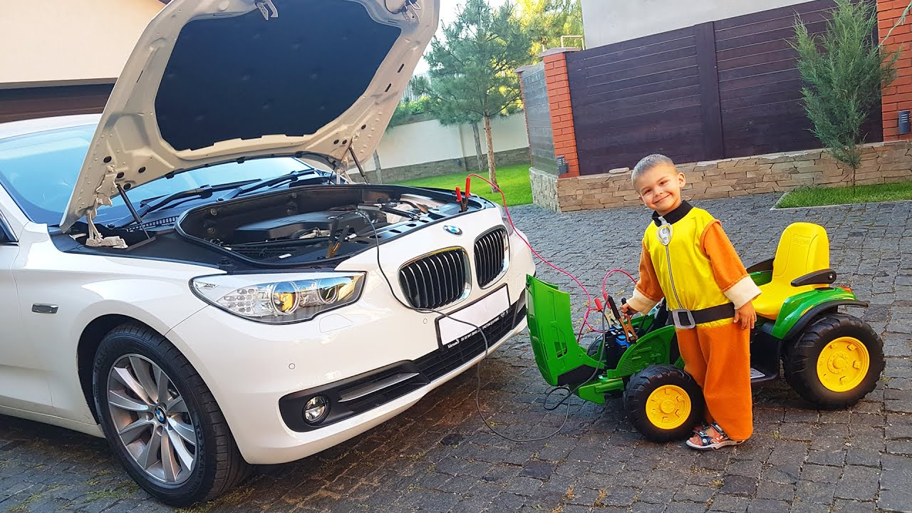 The Bmw Car broken down Dima Ride on POWER WHEEL Tractor to help man