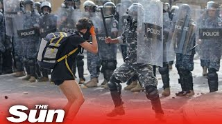 Live: Lebanese riot police fire tear gas at protesters in Beirut