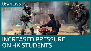 Hong Kong police increase pressure on students in campus siege | ITV News