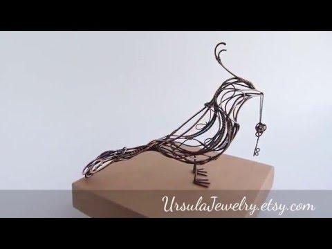 Wire copper Bird with garnet key