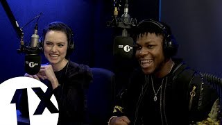 """I've never seen Love Actually"": John Boyega and Daisy Ridley play the Christmas movie game"