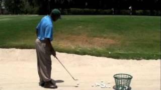 One handed golf shots by Christian Bernard