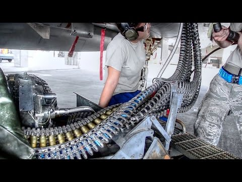 Air Force Weapons Loaders Arm F-15 Fighters
