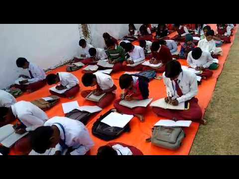 School where kids writes with both hands simultaneously