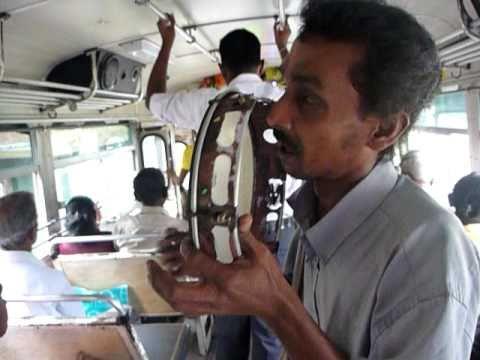 Sri Lanka,ශ්රී ලංකා,Ceylon,Blind man singing in bus