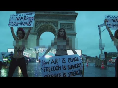 'Welcome war criminals!': Topless FEMEN activists protest in Paris ahead of WWI armistice centenary