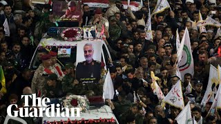 'Death to America': grief and fury as thousands mourn death of Qassem Suleimani