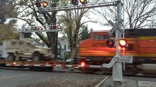 BNSF 7224 Military Vehicle Train With NS Passing H Street Railroad Crossing Northbound
