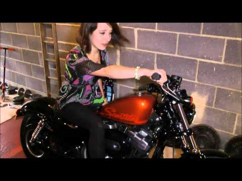 Hot Girl Revving Harley 48 with Vance & Hines short shots